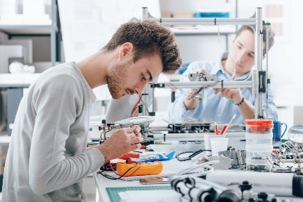 College website photos: Male student in lab