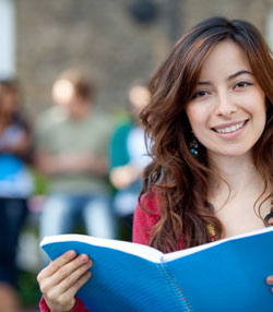 A photograph of a college student who would take a non-cognitive attitudes assessment to help guide their college or university campus.
